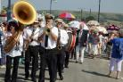 CROWDS: A previous Swanage Jazz Festival parade travels along the seafront and through the town
