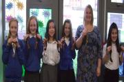 CUT: Kelly Paixao, Milly John, Mariana Mengotti, Oliwia Ochnik, Adaya Brandon and teacher Sarah Melbourne all had plaits of at least seven inches cut off at St Michael's primary school