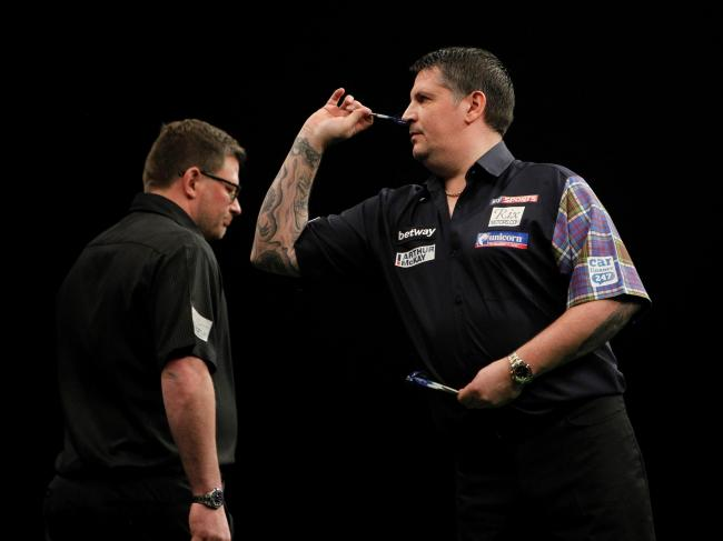 HEAD TO HEAD: Gary Anderson, right, takes on James Wade, left, at the BIC tonight (Picture: PDC)
