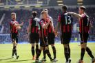 TEAMWORK: Cherries players celebrate Marc Pugh's goal at Everton on Saturday