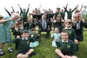 Burton Primary School head teacher Dean Buckland with pupils to celebrate their recent Ofsted report..