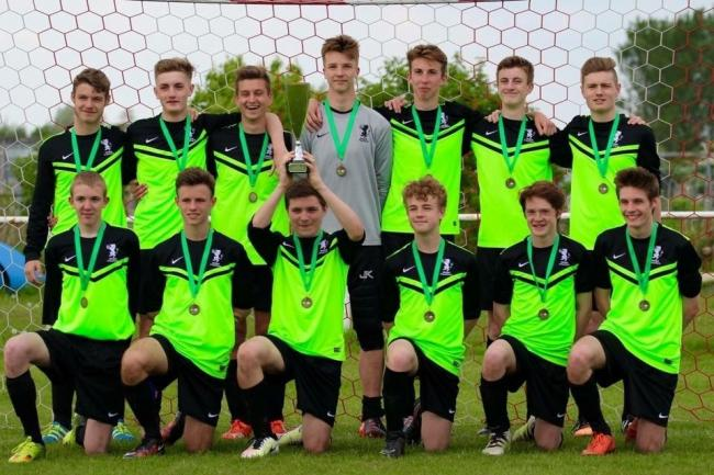 CHAMPIONS: Grange Athletic under-16s lift the Bankes Cup