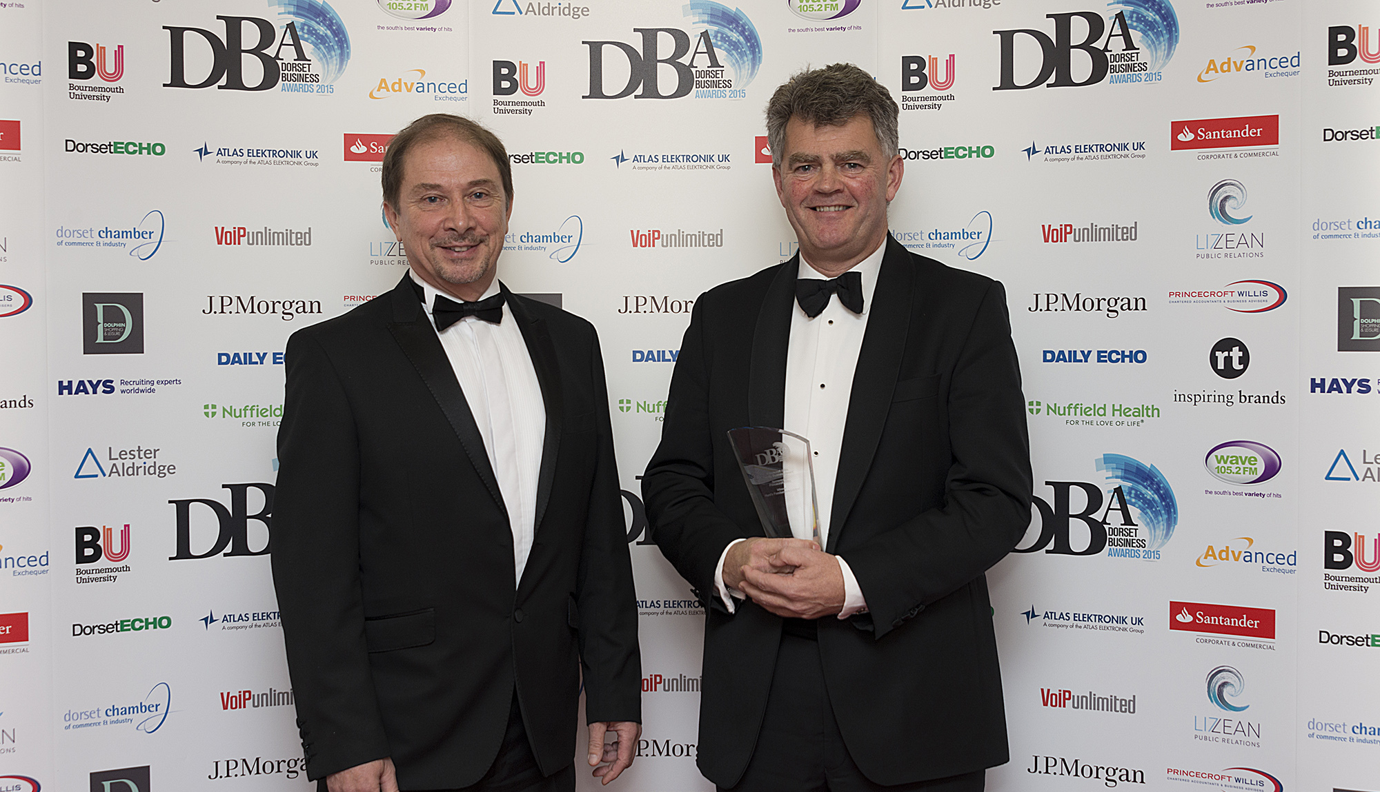 CHAMPION: Nick Love of Princecroft Willis and Richard Hunt of Hunt's Foodservice Ltd, last year's winner of the Family Business title at the Dorset Business Awards