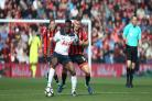 GETTING A GRIP: Jack Wilshere battles with Tottenham midfielder Victor Wanyama at Vitality Stadium