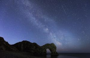 Bournemouth Echo: This picture of a starry Durdle Door was taken by Echo Camera Club member Rory Puddle. Click to see more.