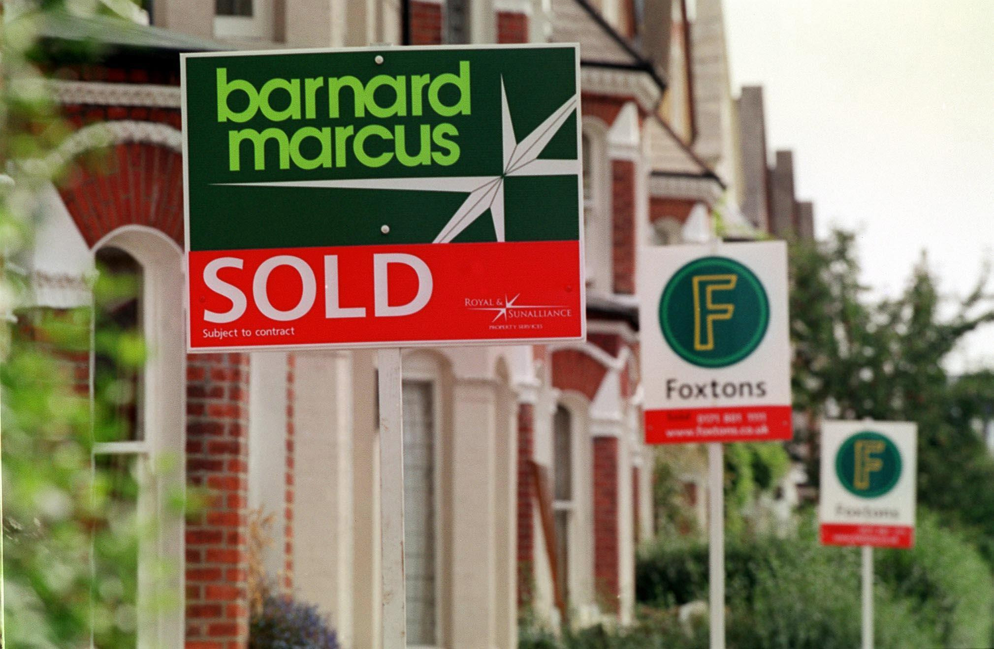 File photo dated 14/12/2001 of estate agent signs on a London street. House prices soared by an average £5,500 over the first six weeks of the year on the back of record numbers of potential buyers, figures showed Monday February 16 2004. Property webs