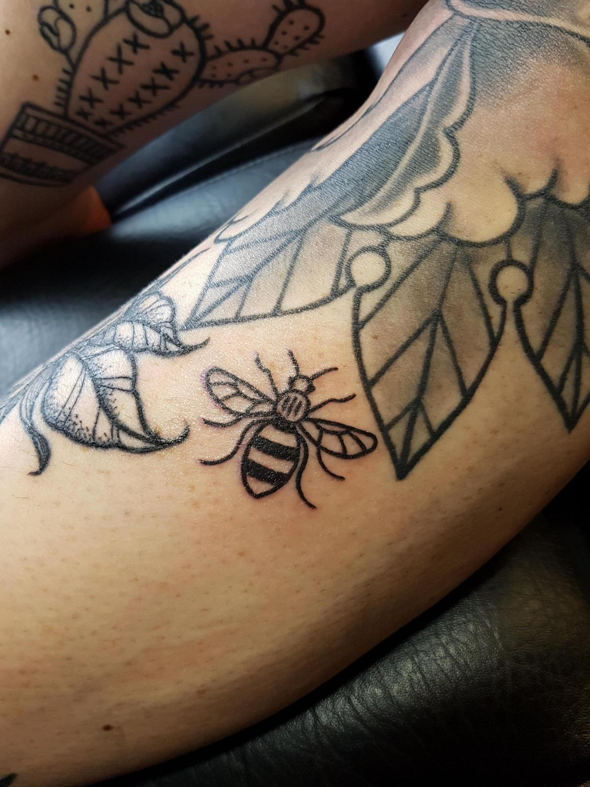 Tattoo studio inks dozens with bee symbol for manchester appeal tattoo studio inks dozens with bee symbol for manchester appeal biocorpaavc Gallery