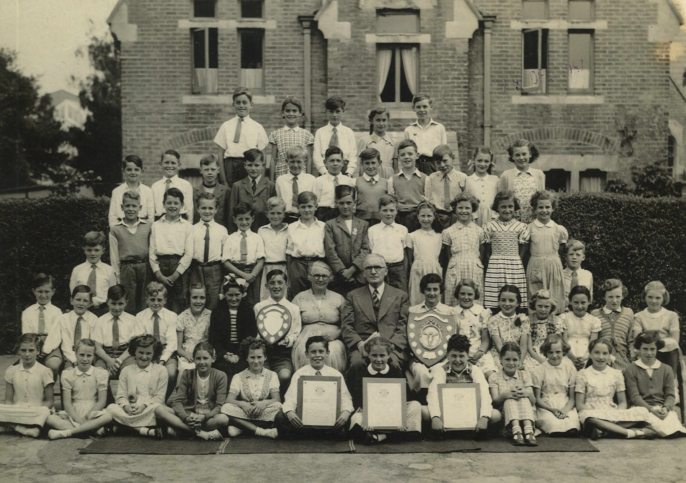 Boys and girls choirs at St Michael's primary school, West Cliff, Bournemouth, after they had major wins in the Bournemouth Music Festival in 1951/52 with headmaster George Mansfield and teacher Mrs Knight. Picture sent in by Stanley Pretty who is in
