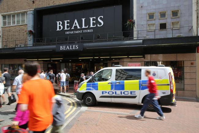 PROTEST: Police at Beales after Sunday's demonstration