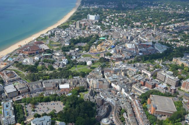 Aerial GV of Bournemouth seafront, Bournemouth town centre, Bournemouth Beach, the BIC, shops and roads...Please use with credit to Bournemouth Helicopters...Emailed to us by Gareth John, at Wordcaster Media and Public Relations, on:Gareth@wordcaster.net/