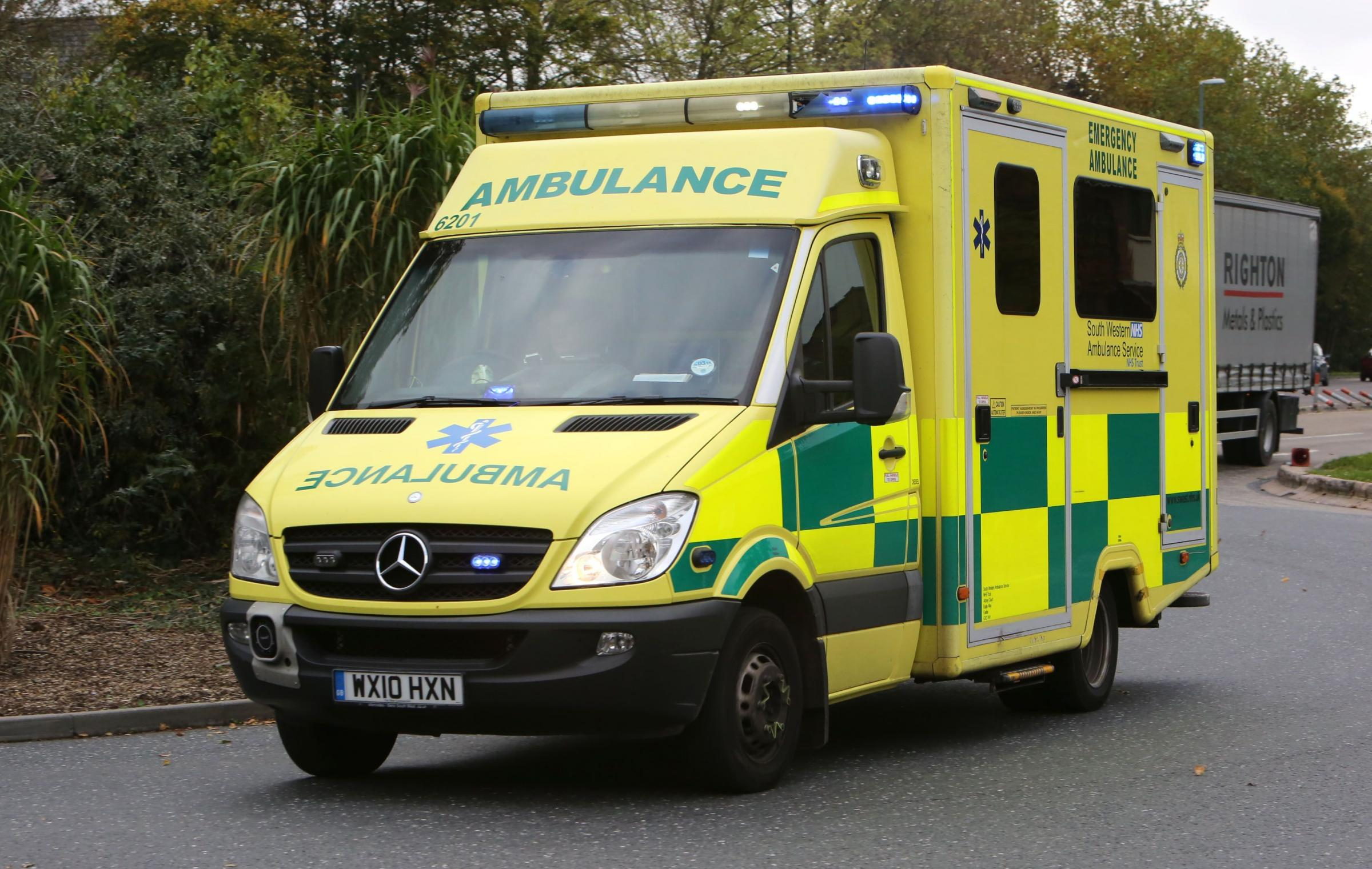 Picture by Richard Crease  - 27/10/14  - RC271014bAmbulance1 - stock photo  -  South West Ambulance with blue lights on.