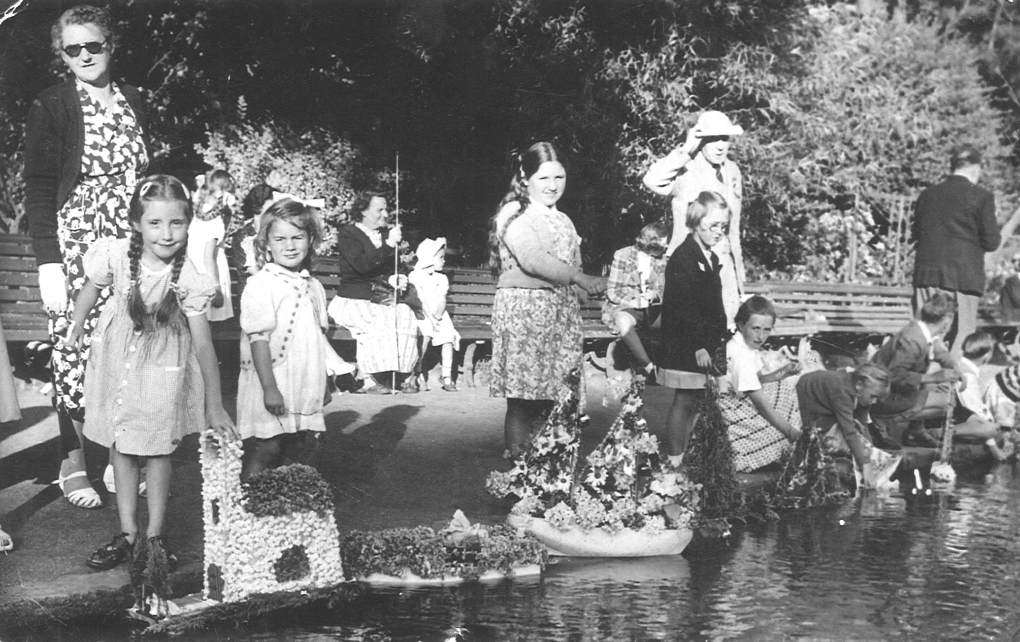 Janet Christopher (nee Gawler) of Ringwood sent in a picture of Bournemouth Regatta boat decorating competition on Bourne Stream, Bournemouth Pleasure Gardens, in 1952. She is the small girl in a white dress and her boat was decorated with a lady in a gar