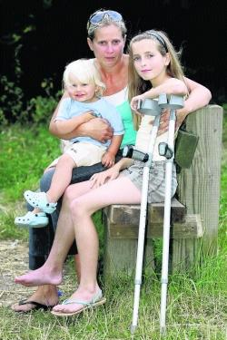 BACK HOME: Mollie Hawker, 10, with mum Karen and two-year-old brother Ellis