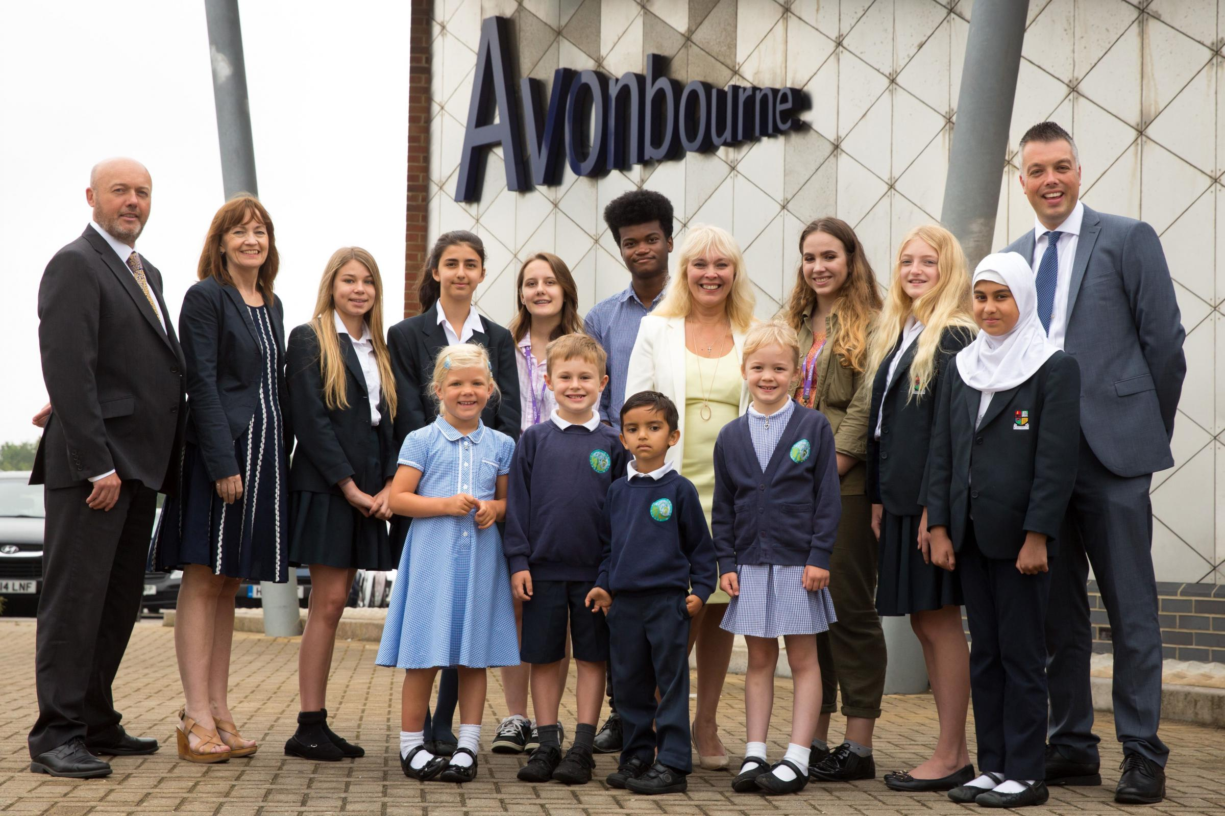 Pupils from Avonwood Primary, Avonbourne College and Avonbourne Sixth Form celebrate their Good Ofsted. Pictured with: Far left Principal of Avonbourne College, Jason Holbrook; Director of Sixth Form, Kathryn Loughnan (second left); CEO of Avonbourne Trus