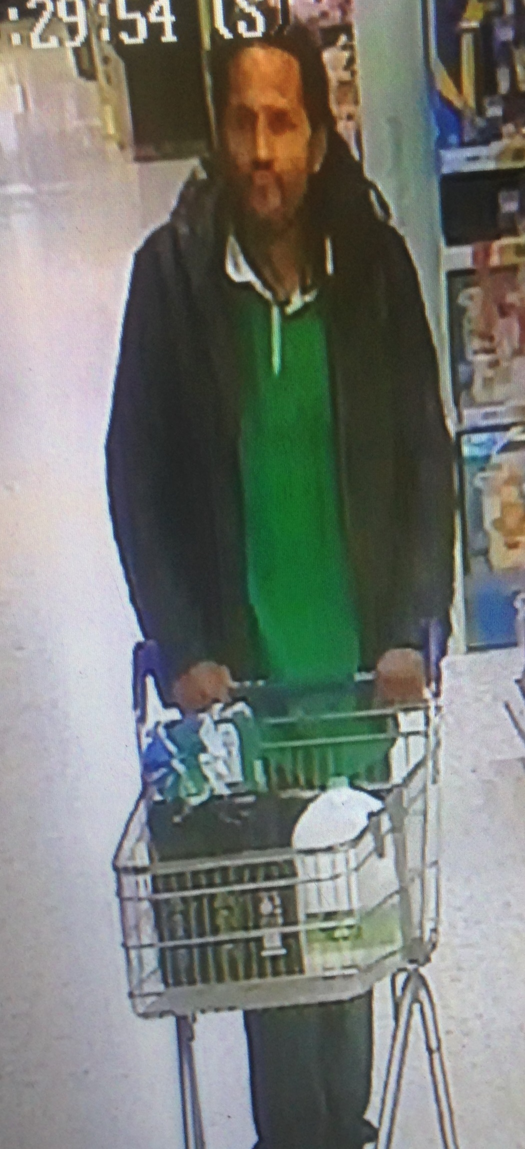 CCTV image of a man police would like to speak to following attempted thefts at Tesco stores