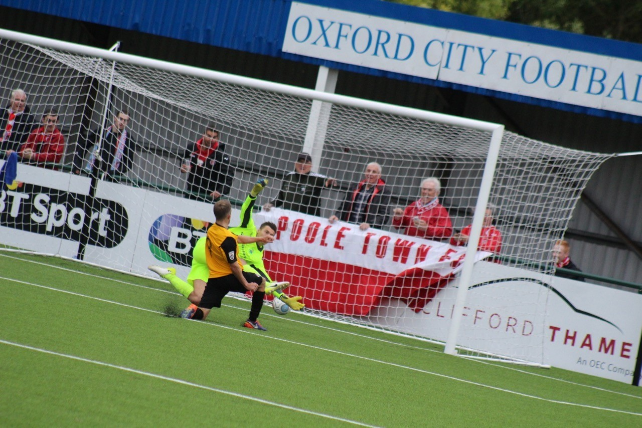 BACK OF THE NET: Poole Town's Warren Bentley pokes home against Oxford City (Picture: Jordan Jones)