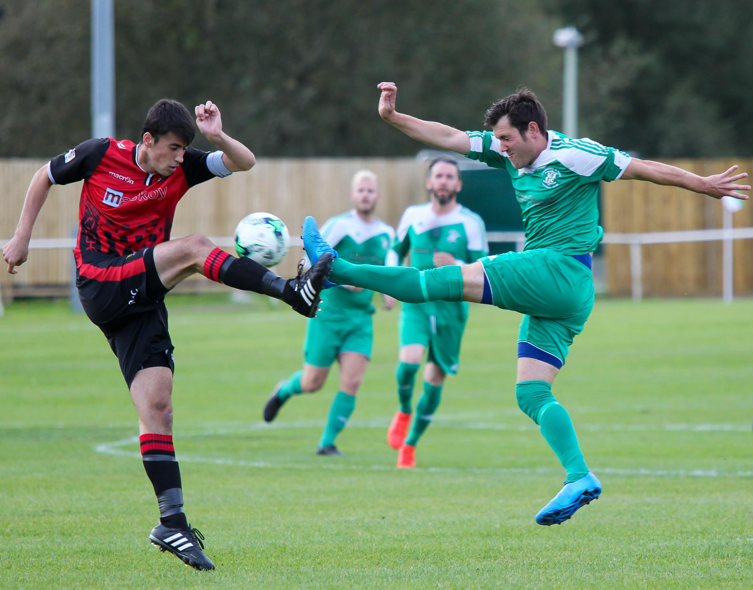 SUSPENSION: Zak Pickett (left), pictured in action for former club Romsey Town