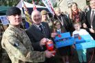 The launch of the 2017 Dorset County Poppy takes place at Corfe Castle Station in Purbeck. .The chairman of the Appeal Jerry Nunn buying the first poppy in Dorset. ..