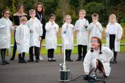 Pupils of Avonwood Primary School enjoy their new Science Club with teacher Mr Clench helped by sixth formers and Avonwood headteacher Mr Jackson.