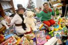 Natalie Newman of Amelia's Rainbow, left, at the Bournemouth Echo offices at Richmond Hill in Bournemouth to collect toys from the 2017 Toy Appeal. ..