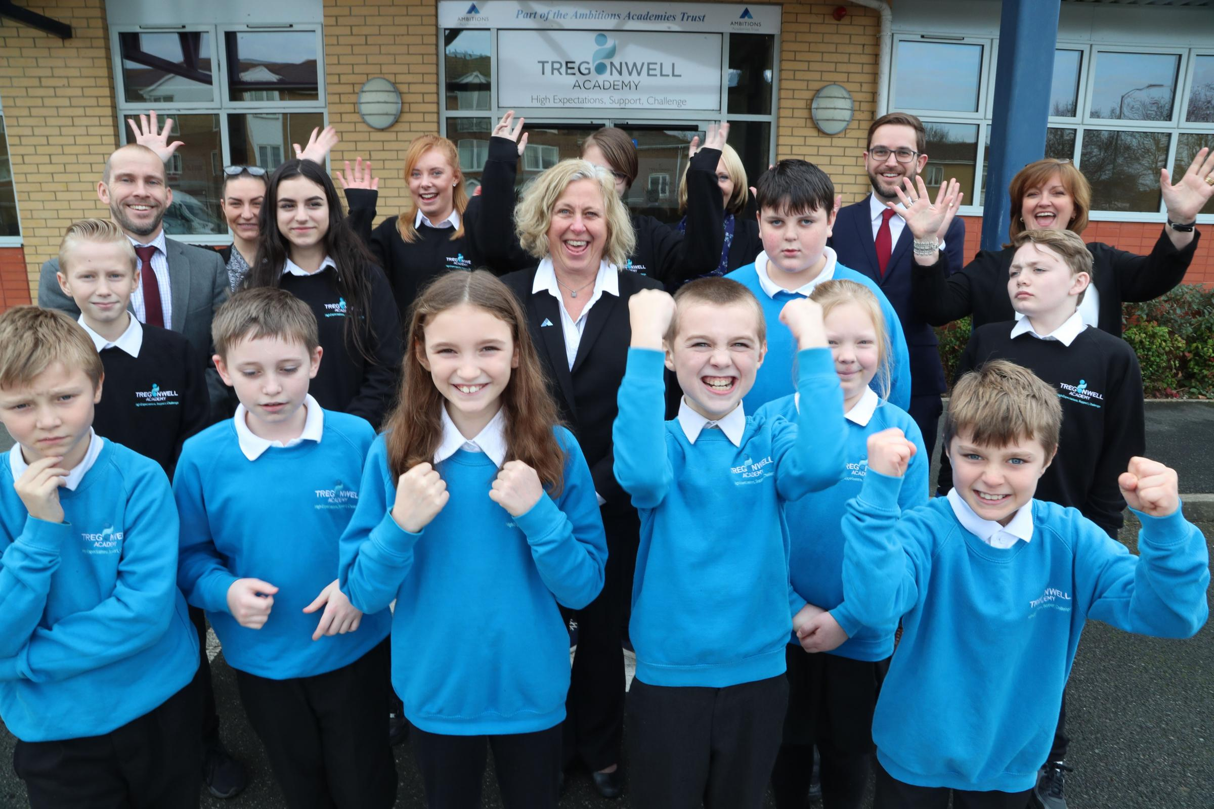 Staff and pupils of the Tregonwell Academy, including Ambitions Academies CEO Sian Thomas (centre), celebrate their Outstanding Ofsted Rating.