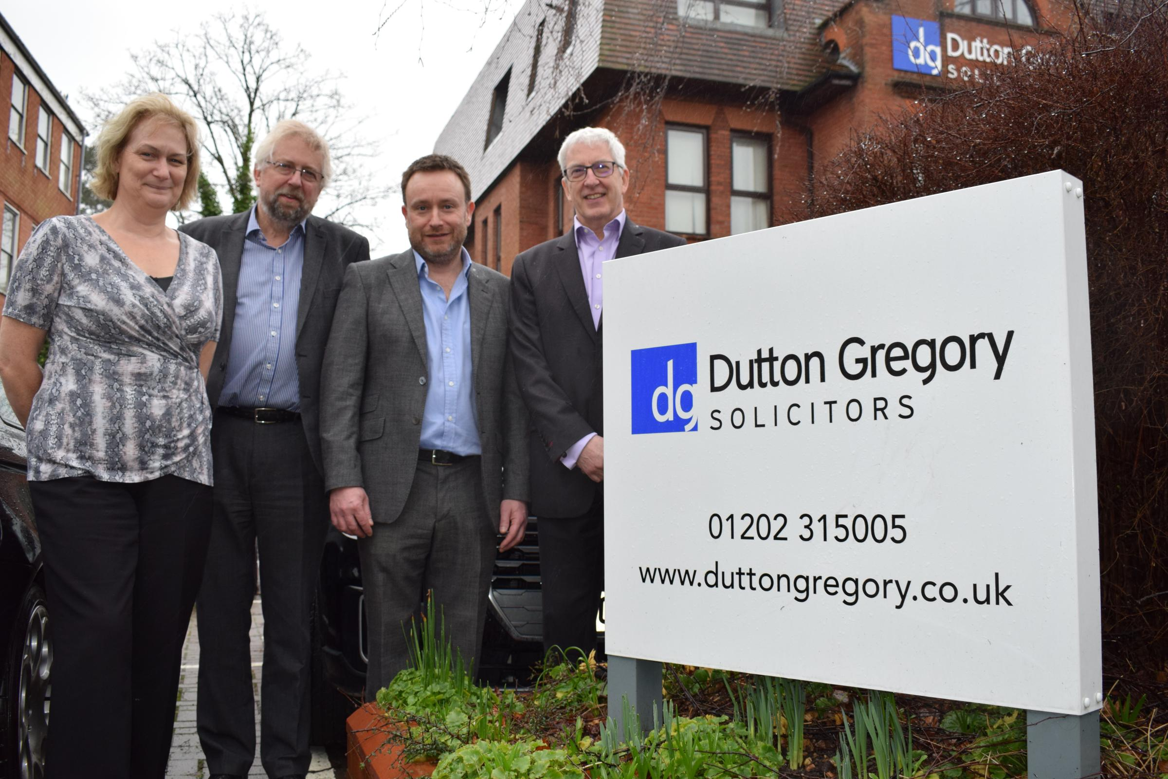 Staff from law firms Turners and Dutton Gregory prepare for their merger
