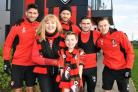 AFC Bournemouth play Stoke City on World Cancer Day (Feb 3) and are using the match to raise awareness of the work of Dorset Cancer Care Foundation (DCCF). Players are seen here with young DCCF charity fundraiser Josh Chown, from Bournemouth and DCCF trus