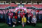 The Deep South Media team at AFC Bournemouth's Vitality Stadium. Back row, from left, Cliff Moore, Mike Ribbeck, Alison Latta, Cherries commercial director Rob Mitchell, Ron Wain, Cherries chairman Jeff Mostyn, Debbie Granville, Andrew Diprose. Front ro