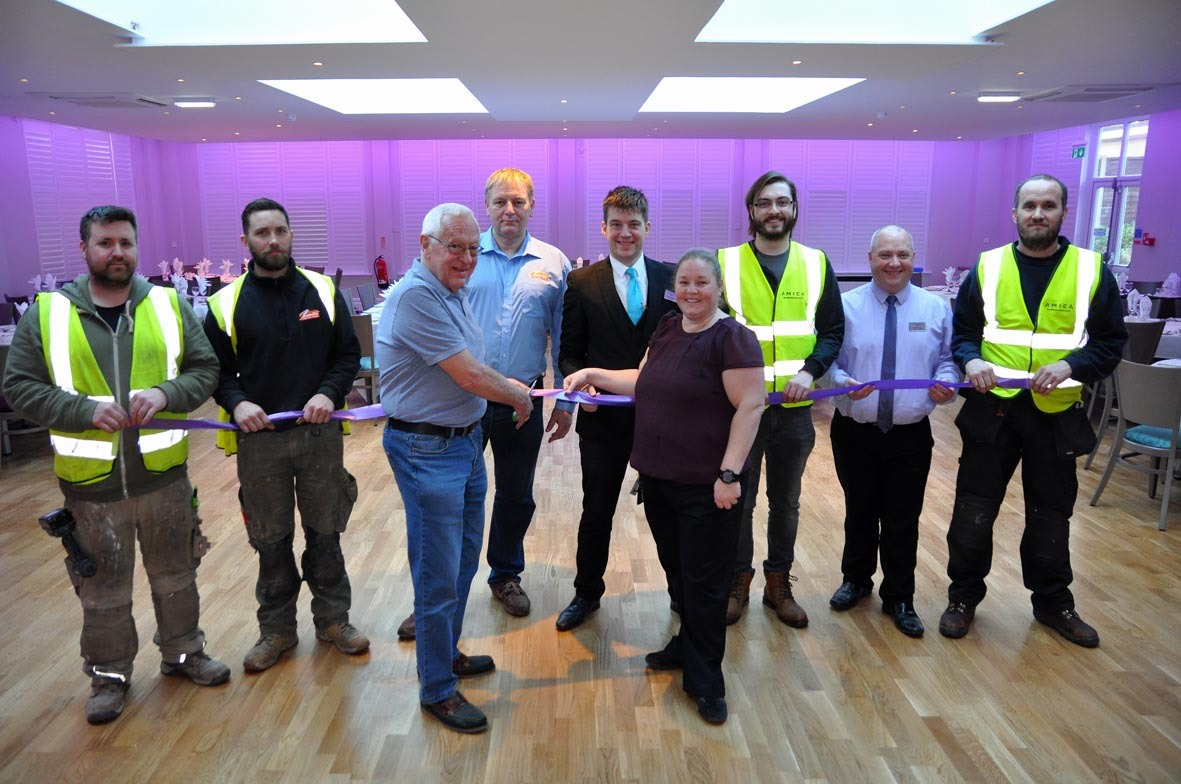 Colin Phipp of the Good Companions Lodge cuts the ribbon on the new dance floor and restaurant at the Marsham Court, watched by hotel managing director Rosie Wallace and members of Chewton Bespoke Homes Design and Build of Highcliffe