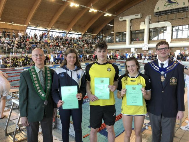 ALL THE PRESIDENTS' SWIMMERS: Swim England president Richard Whitehead (right) and Dorset ASA president Chris Gassman (left) present county record certificates to (l-r) Kayla van der Merwe (BCS) and Poole's Jacob Peters and Jazz McCrea