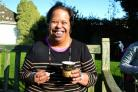 Michelle, an adult supported by Dorset disability charity Diverse Abilities, enjoys ice cream donated by Purbeck Ice Cream