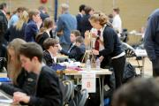 150 students from local schools take part in the annual Rotary Technology Tournament at Bournemouth Collegiate School in Bournemouth. .Students work on the rocket launching systems they have been tasked with creating. ..
