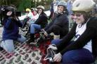 FUN ON THE SLOPES: BBC weather presenter Georgie Palmer lines up with youngsters from the Youth Cancer Trust at Snowtrax