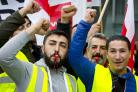 Public workers on strike at the international airport in Frankfurt (Michael Probst/AP)
