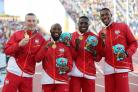 England's (left-right) Richard Kilty, Reuben Arthur Harry Aikines-Aryeety and Zharnel Hughes with their 4x100m relay gold medals. (Martin Rickett/PA)