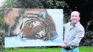 TIGER, TIGER: Bournemouth artist Jonathan Truss with his most recent painting, Miss Siberian