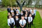 St Michael's Middle School has installed a new angel sculpture in its grounds. Pictured with it are members of the school council with headteacher Ron Jenkinson and collective worship lead Anna Thompson-Brown.