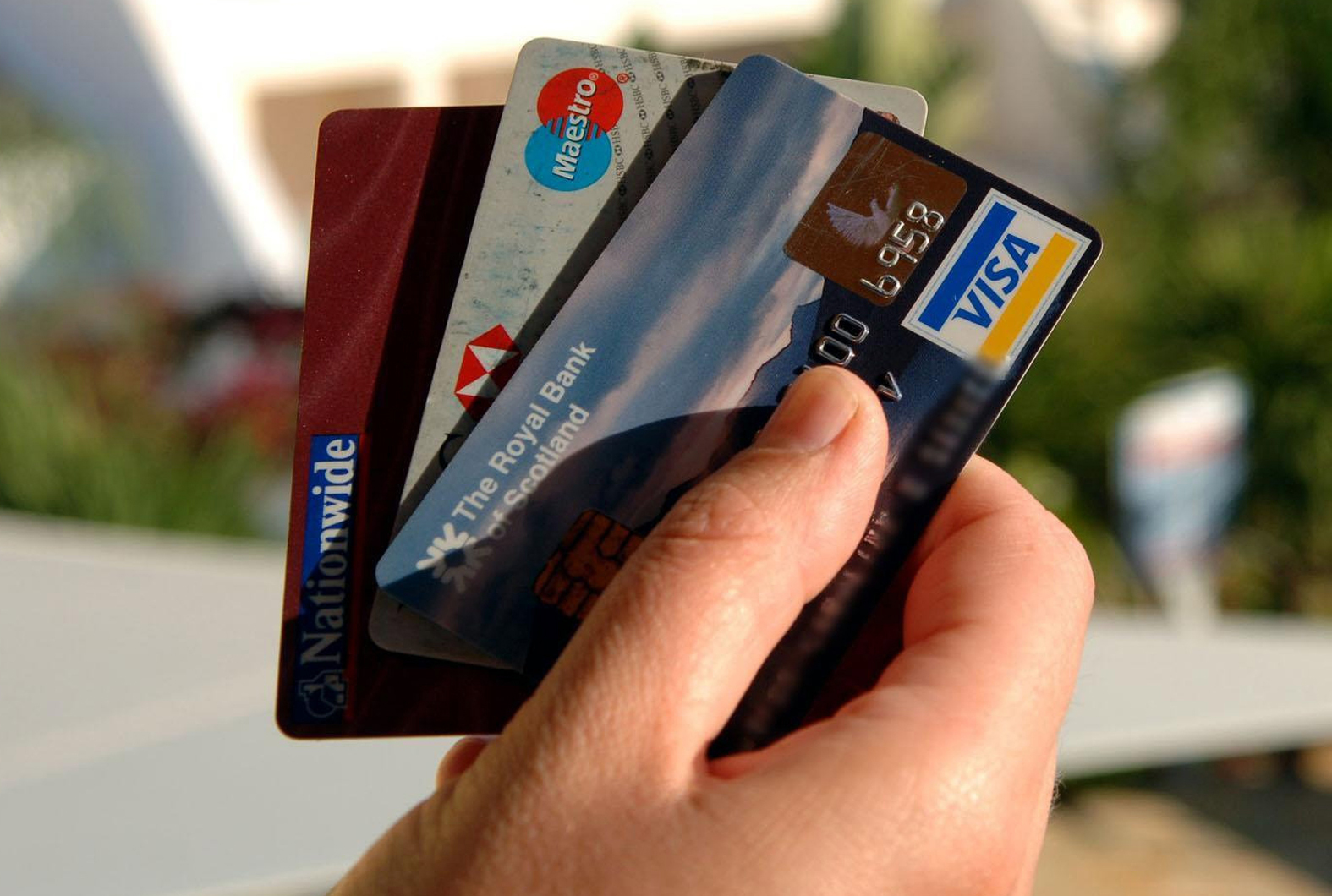 EMBARGOED TO 0001 MONDAY JUNE 4  A man holds a selection of credit and debit cards at a resort in the Algrave, Portugal..