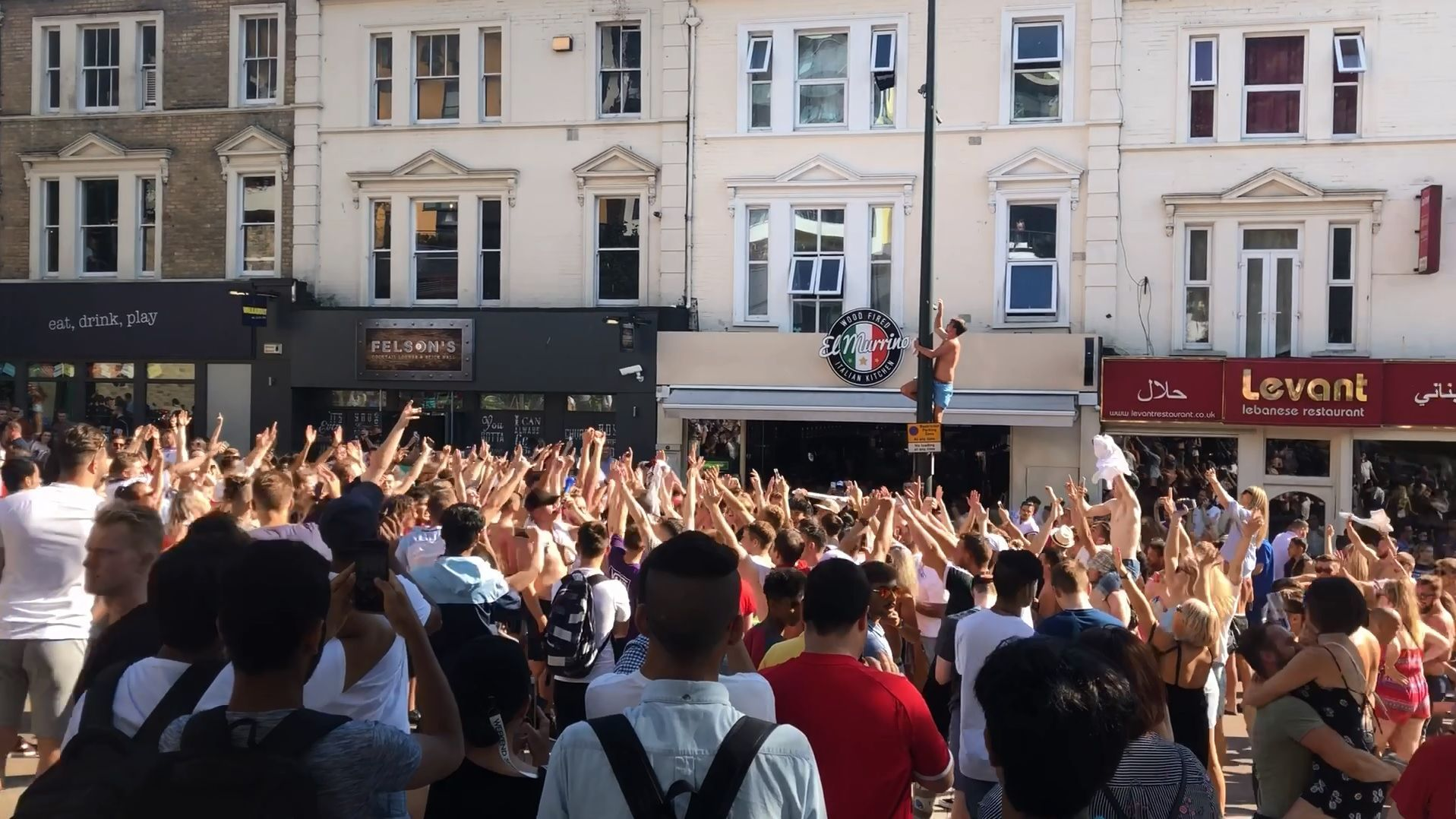 England fans celebrate quarter final success in Walkabout and out on Old Christchurch Road, Bournemouth