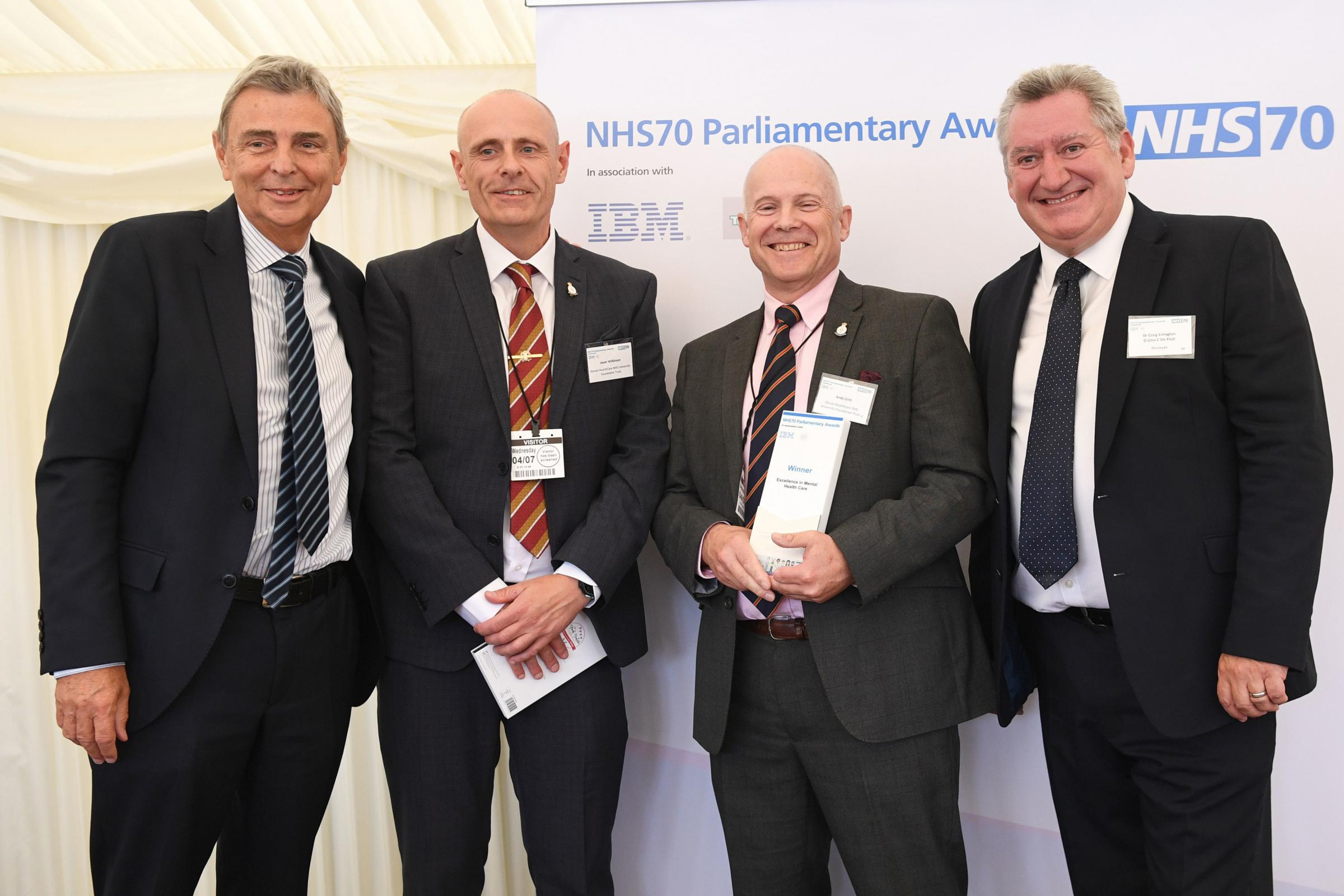 Jason Wilkinson (second left) and Andy Gritt (second right) of Dorset armed Forces Community Health and Wellbeing Project receive their Excellence in Mental Healthcare Award from UNISON General Secretary Dave Prentis (first left) and Dr Cr