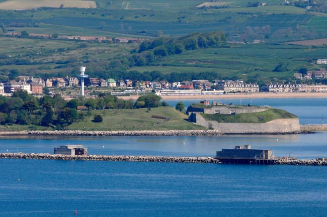 View across Portland Harbour from Verne Common Road to Nothe Fort in Weymouth