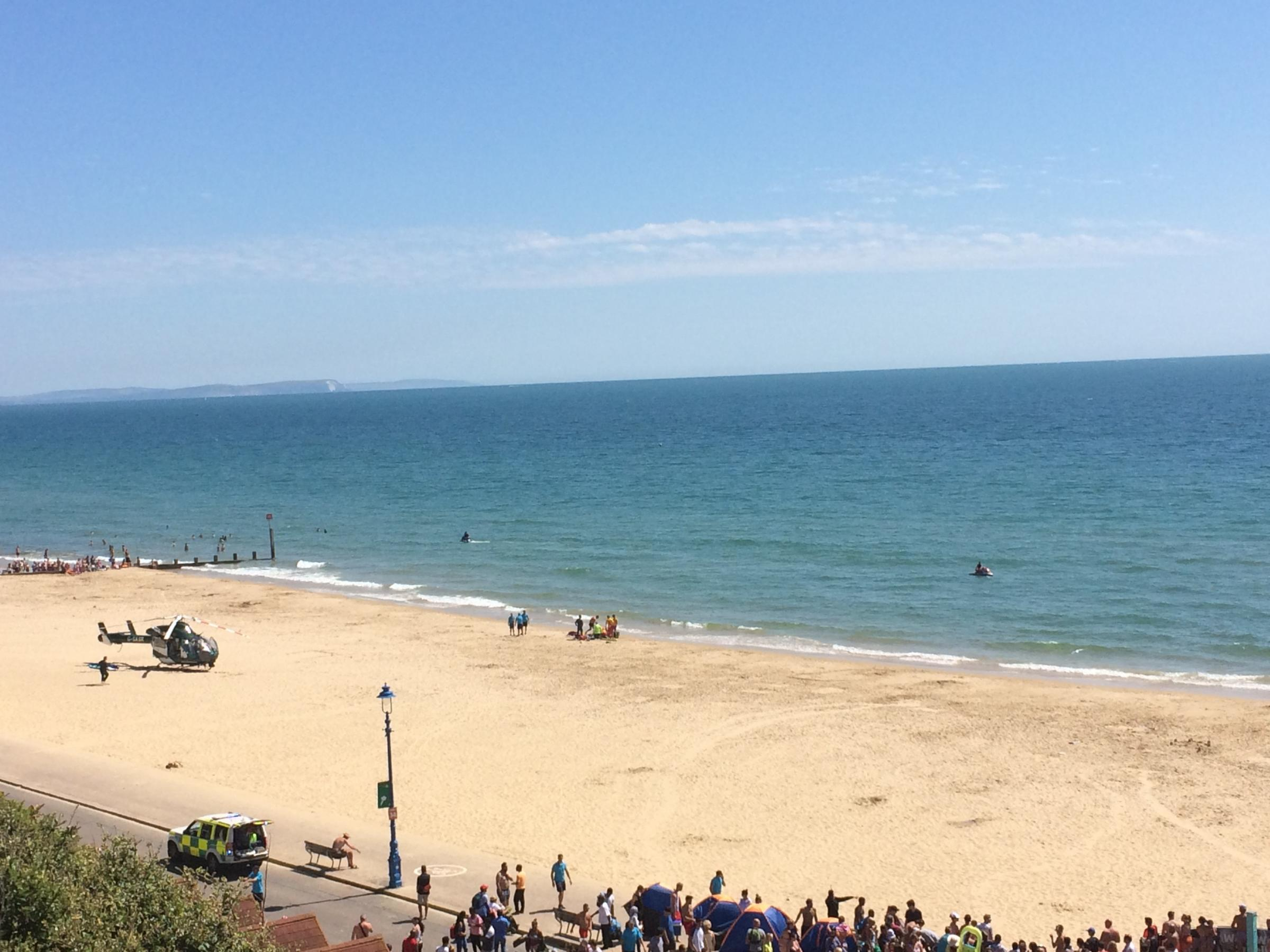 The scene on Bournemouth beach, near Harry Ramsden's, where a man was taken ill in the sea
