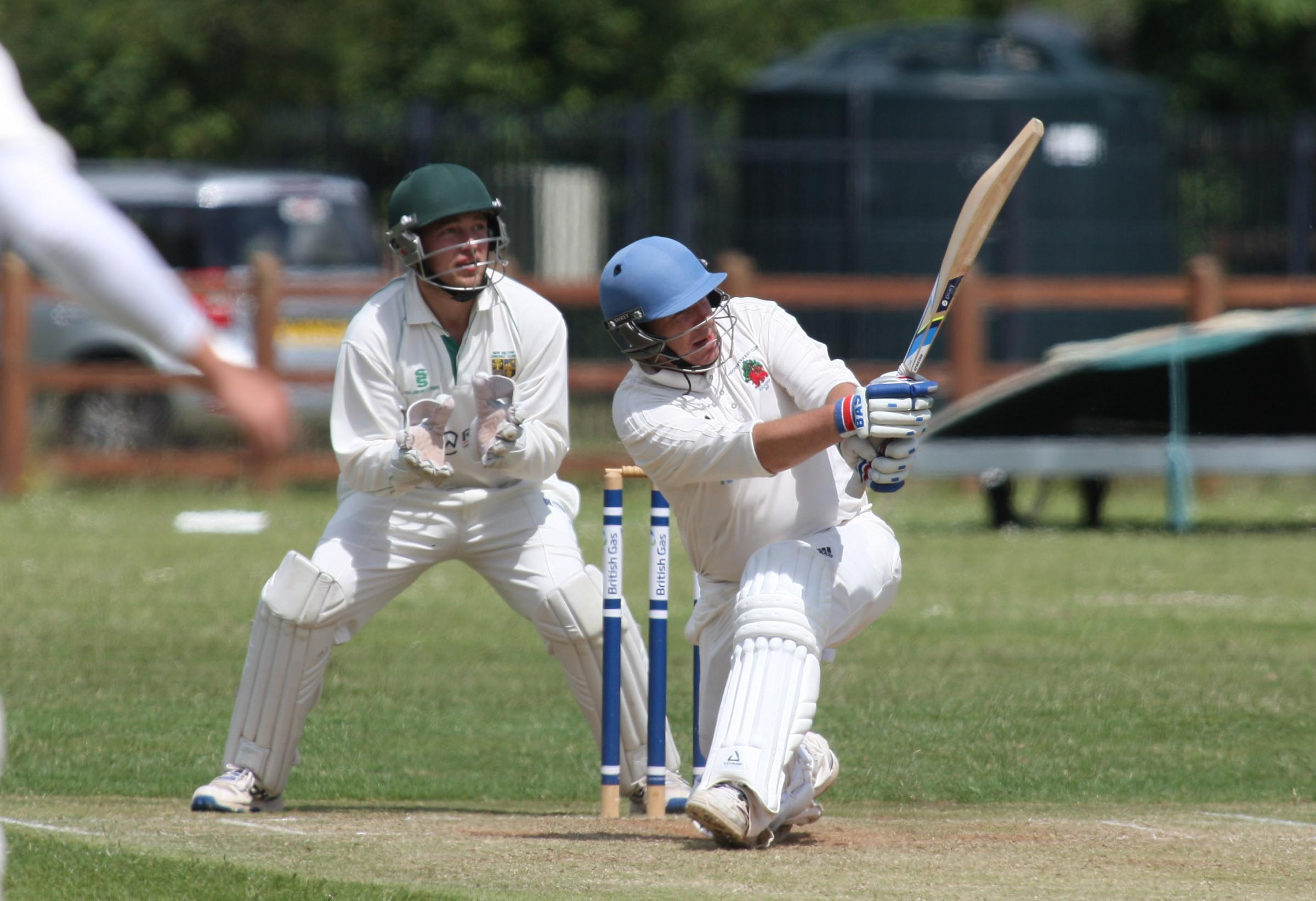 Cricket Action - New Milton V Andover at  Fernhill Sports Ground. Andover's Dave Watson and New Milton keeper Tom Arnold.