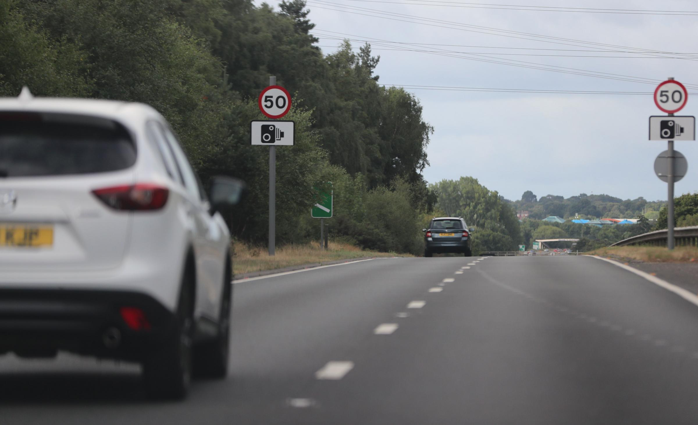 New 50mph signs which extend the Wessex Way speed limit north of the Blackwater junction onto the Spur Road in Bournemouth. .Signs on the southbound carriageway..
