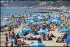 SUN SCARE: Revellers enjoying Bournemouth's packed beaches this summer. Picture, Phil Yeomans/BNPS