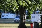 Travellers vehicles on playing fields at King's Park in Bournemouth..