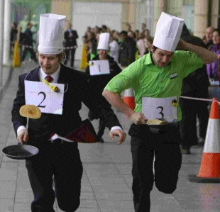 EGGING EACH OTHER ON: Shop workers at Castlepoint take part in the centre's second annual pancake race