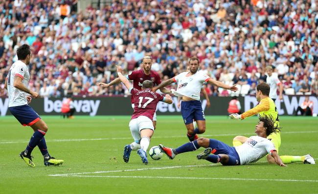 PENALTY GIVEN  Cherries star Nathan Ake slides in on West Ham s Chicharito 4e3f75c33