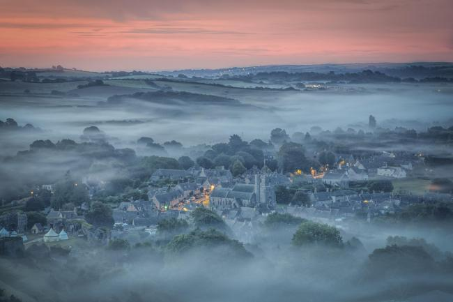 Echo Camera Club Dorset picture. .Meet the Photographer feature - Emily Endean. .The village of Corfe Castle covered in a blanket of mist. .MUST credit the photographer..