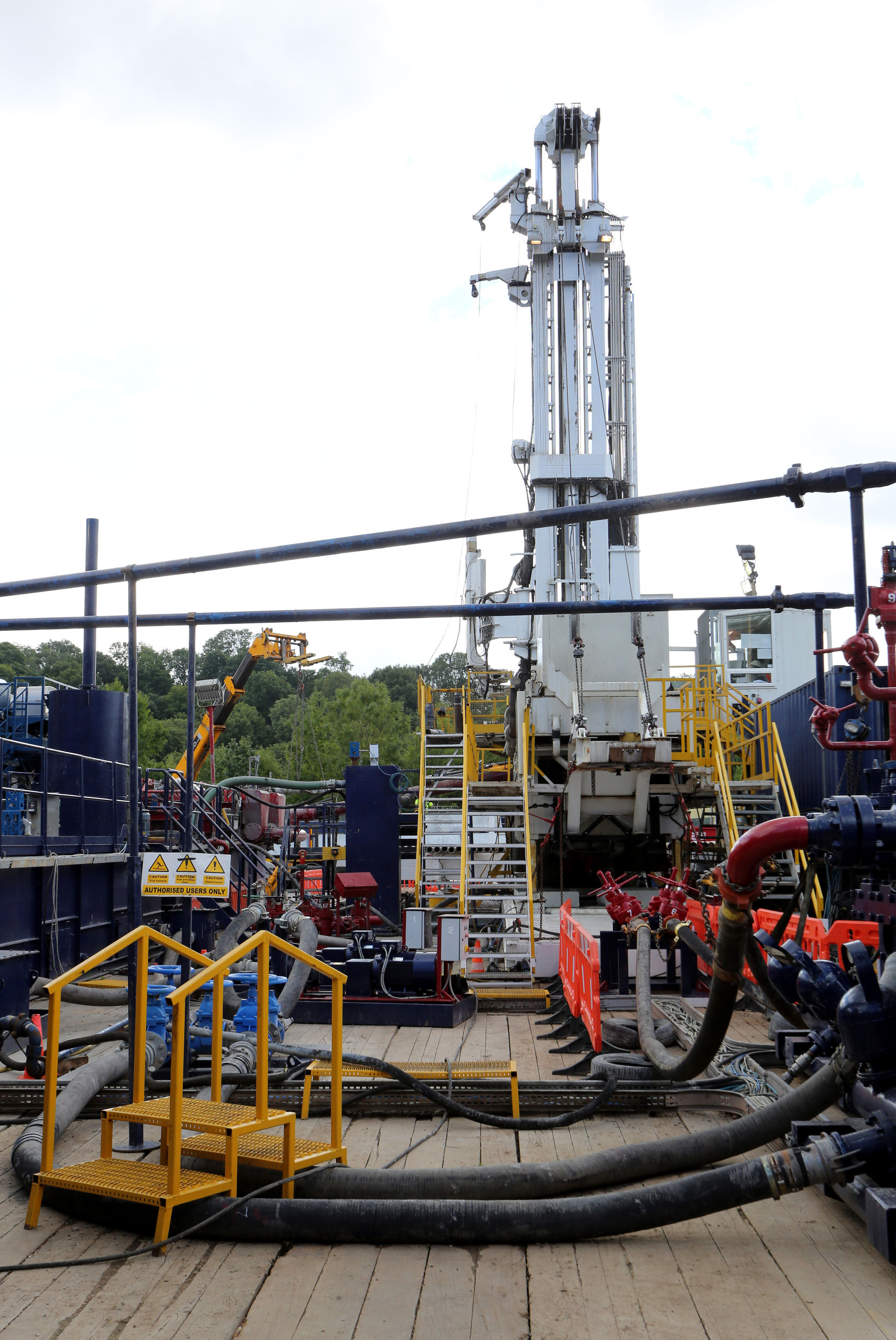 File photo dated 16/08/13 of a fracking exploration drilling site, as individual households will be given cash payments potentially running into thousands of pounds in recompense for fracking in their area, under new plans announced by Theresa May. PRESS
